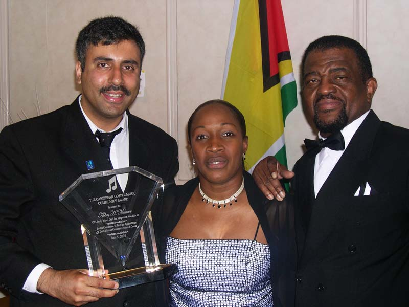 Dr Abbey being Presented Gl Award by Hopeton lewis 2001