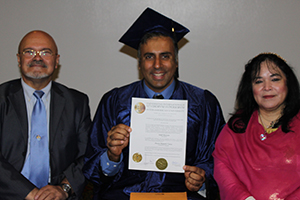 Dr.Abbey with Dr Fernadnez_&_Haddasa Holding up Phd Degree