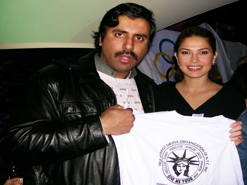 Miss Universe 2002 Holding UP our Tee Shirt 2002