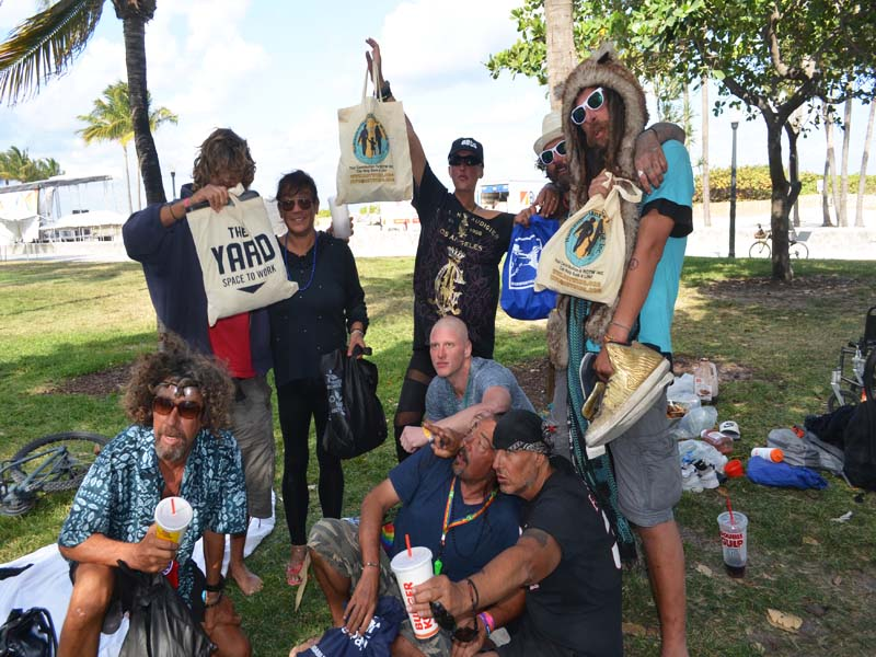 LGBTQ Homeless recipients holding up Hotw Bags